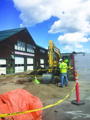 While digging out the apron outside Station 1 workers found a smelly issue—a sewer line was broken beneath the old concrete area.