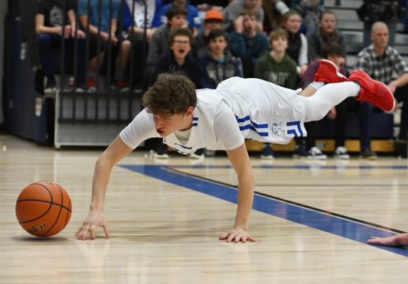 Senior Cole March pulls off a seriously modified pushup during the Feb. 2 game against Manhattan Christian.