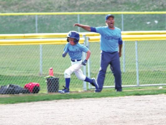 """The Bartoszek express: Father Ray waves son Owen home on Thursday, May 10. On Monday, May 14, the Royals played in front of """"a record crowd"""" reported Ray, writing in a post-game email, """"11-5 over the Mets. Winning streak extended to seven games."""""""