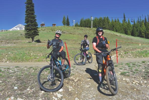 The first-ever full-time professional bike patrol will be out on the trails at Big Sky Resort this summer making sure everyone's keeping it safe and having a good time. They're not in their uniforms in this photo, but will be sporting a cross on the trails so users know they're there to help. Left to right: Regan Christian-Frederick, Katie Williamson, Tom Moran.