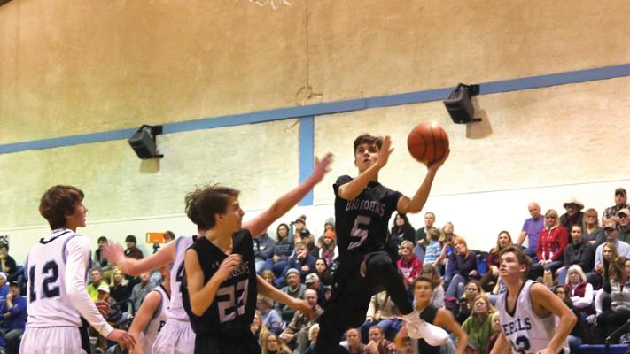Point guard Kolya Bough skies to the hoop. He finished the Shields Valley game with 5 points.