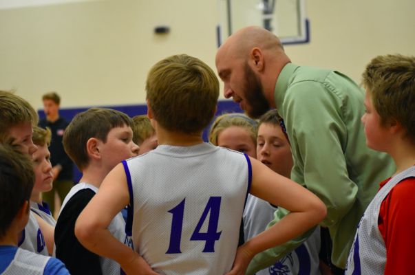 Coach Lucas Westblade guides his young players as they compete in teams comprised of both fourth and fifth graders.