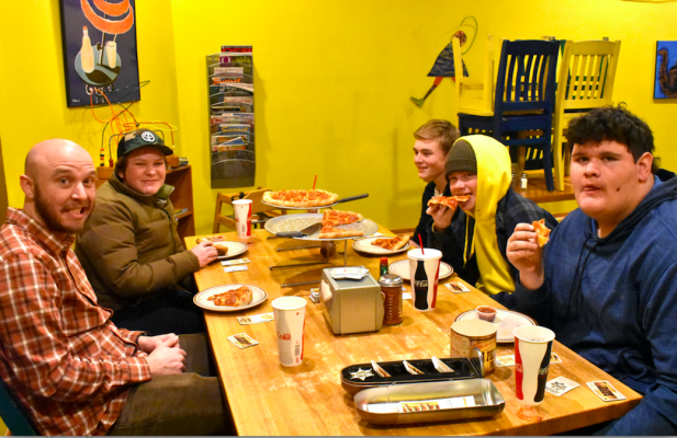 """Lucas Westblade, Ethan Parker, Pierce King, Sam Alvin, Kole Maus enjoy are recent Young Life meeting, eating pizza at Blue Moon and playing BANG! """"It's like old western Mafia, if you've ever played Mafia before,"""" Westblade explained."""