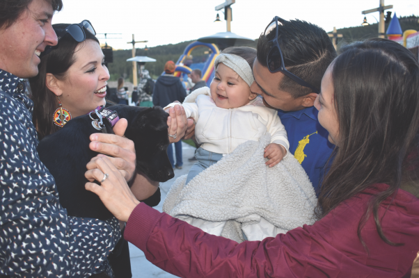 Jesse, Karen and Aranza Campos meet Ande the puppy (named for Andesite) and say hello to Brooke and Justa Adams. Photo by Jana Bounds