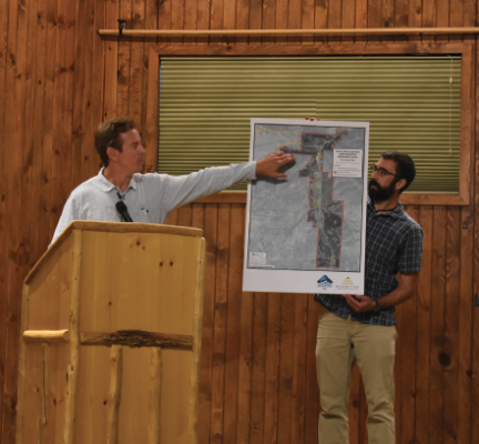 AE2S project manager Scott Buecker and WGM representative Chris Allen show meeting attendees the district boundary lines created during the previous study. PHOTO BY JANA BOUNDS