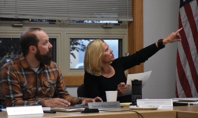 Attorney Kim Beatty gestures toward the working redlined document shown on the screen. The board was able to edit section by section. PHOTO BY JANA BOUNDS