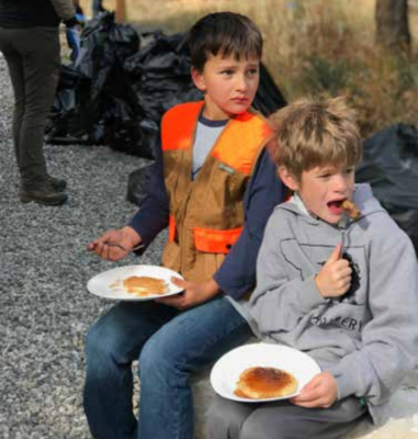 Kids enjoying breakfast after clean up. Please join in this year September 27 at 10am. PHOTO COURTESY OF JEREMY HARDER