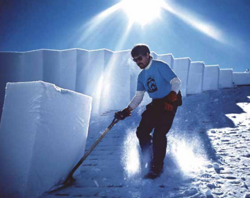 Winterkeeper for Yellowstone General Stores for the last 41 years, Jeff Henry in an action shot removing gigantic blocks of snow from the roof of the Canyon General Store in 1999. PHOTO COURTESY OF JEFF HENRY