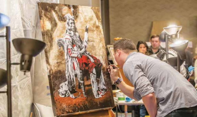 Artist Ben Pease finishes a painting at the 2020 Auction for the Arts. PHOTO COURTESY DAVE PECUNIES
