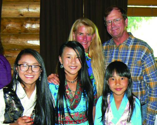 Peter Schmieding and his wife Karen Fellerhoff pose with their adopted Sherpa daughters Palden Janmu, Tashi Jangmu and Tashi Dawa a few years ago. Through her passion for Nepal, Karen and her friend Tsering began helping young Nepalese girls gain an education. With guidance from Peter, they started Tsering's Fund in 2006, and have since helped over 150 girls and many other Nepalese children through the fund.