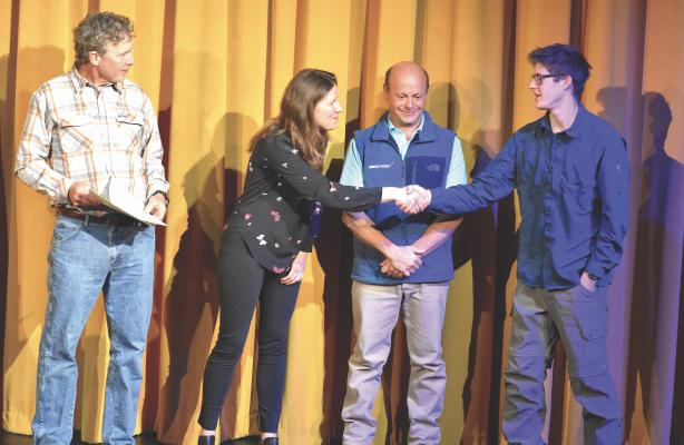 Howie Robin accepts the Bartoszek Scholarship for a Scholar Athlete from Lydia and Ray Bartoszek and the Spanish Peaks Community Foundation Scholarship from John Haas. Robin was still deciding where to head to school, either in Colorado or Washington for political science or journalism. He's currently working with his family to organize his father, Mark  Robin's, extensive writing, preparing the words for publication. Mark  passed away in December, 2017 from ALS.