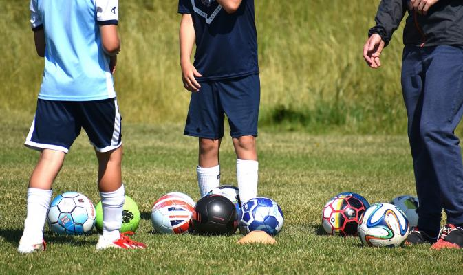 Young futbol players practice at the Big Sky Community Park on Aug. 7.