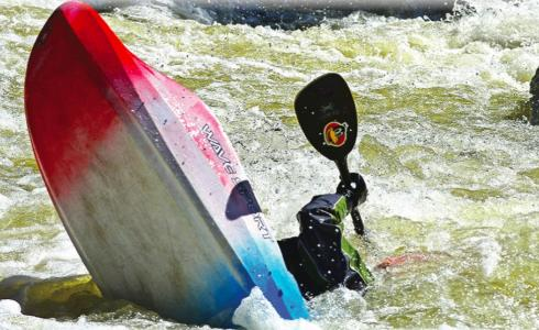 Louis Bishop does a perfect stern squirt at House Rock on May 15 at 2,800 cfs. By May 23, the Gallatin River's flow in the canyon increased to 4,890 cfs.