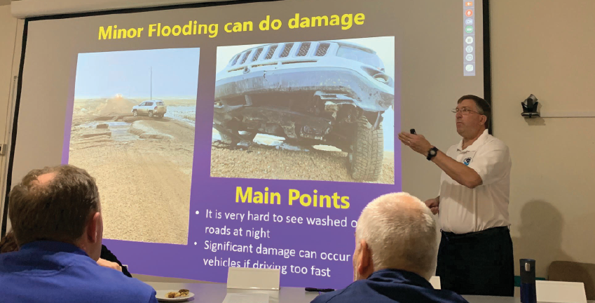 "Jim Brusda, lead meteorologist for the NWS, emphasized the saying, ""Turn around, don't drown."" Barricades are on roadways for a reason. The water is too deep and swift to safely cross or culverts or roadways are washed-out, which can't be seen from the presence of water over the roadway.  PHOTO BY JANA BOUNDS"
