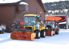 Monsters of machines: Multihog snow removal equipment is parked outside of Buck's T-4 conference room as part of the first ever snow removal safety meeting in Big Sky. PHOTO BY JANA BOUNDS