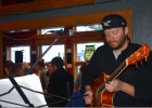 """Après is the best gig in the whole world. Everyone's coming off the hill, they're feeling good,"" musician Brian Stumpf said of his regular Sunday gig at Scissorbills Saloon. PHOTO BY JANA BOUNDS"