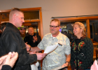 National Guard Infantryman Eric Petz to presents the Patriot Award to his employer John Delzer. John's wife, Toni, stands by with a proud smile.