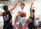Making moves. Big Horn senior Kolya Bough squats mid-air en route for the basket. Bough amassed 18 points that night.