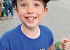 Prepared for candy! Elliot Graham shows his love of parades. PHOTO COURTESY JENNA GRAHAM