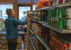 Big Sky Community Food Bank operations manager Sarah Gaither Bivins stocks the shelves. YCCF funds help keep the food bank running. PHOTO COURTESY ANNA SHIPLEY
