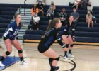 Haley Houghteling (center) gets the dig with Chloe Hammond and Ivy Hicks ready to assist. PHOTO COURTESY KARA BLODGETT
