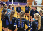 Lady Big Horns huddle up as Coach Missy Botha provides pointers. PHOTO COURTESY KARA BLODGETT