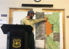 Caleb Schreiber, assistant fire management officer for the Bozeman Hebgen Lake Ranger District shows the difference and distance between the small controlled burn to the south and the over 600 acre wildlife to the north that started in the canyon on Thursday. PHOTO BY JANA BOUNDS