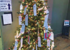 The Giving Tree can be found in the Big Sky Post Office at 55 Meadow Center Dr. #2. Cash donations help fill stockings and provide gifts to children from any last minute Santa letters. Rotarians also make good use of the donations by savvily shopping after-Christmas sales, stocking-up on warm clothes for the following year. PHOTO COURTESY PATTY ALGER