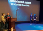 "American Legion Post 99 member Kenny ""Cuz"" Alley and Sons of the American Legion member and Master of Ceremonies Tony Coppola award Ella Henslee first place and Avery Dickerson second place in the Oratorical Contest. PHOTO BY JANA BOUNDS"