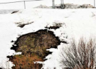 The retaining pond in question in April 2020, environmental groups allege it is discharging pollution while Big Sky County Water and Sewer District General Manager Ron Edwards stated it is part of an under drain system engineered to keep groundwater from interfering with the pond. PHOTO COURTESY OF COTTONWOOD ENVIRONMENTAL LAW CENTER